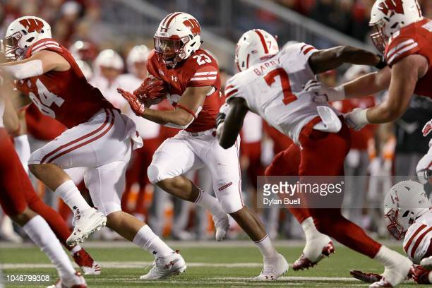 Jonathan Taylor of the Wisconsin Badgers runs with the ball in the first quarter against the Nebraska Cornhuskers at Camp Randall Stadium on October...