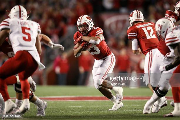 Jonathan Taylor of the Wisconsin Badgers runs with the ball in the third quarter against the Nebraska Cornhuskers at Camp Randall Stadium on October...
