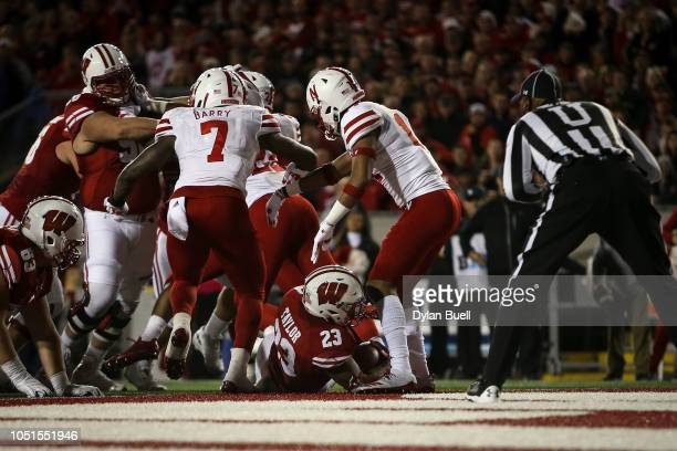 Jonathan Taylor of the Wisconsin Badgers scores a touchdown in the second quarter against the Nebraska Cornhuskers at Camp Randall Stadium on October...