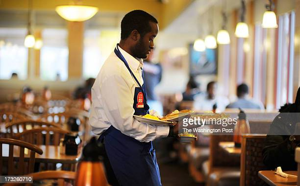 Jonathan Taylor serves customers at IHOP on Alabama Avenue SE on February 16 in Washington DC DC's population east of the Anacostia River makes up...