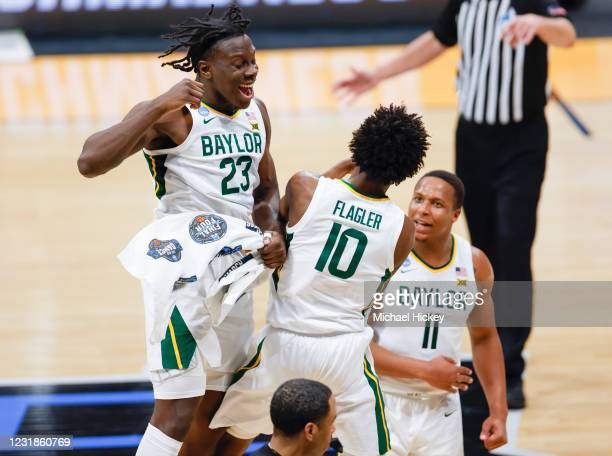 Jonathan Tchamwa Tchatchoua and Adam Flagler of the Baylor Bears celebrate during the first half against the Wisconsin Badgers in the second round...