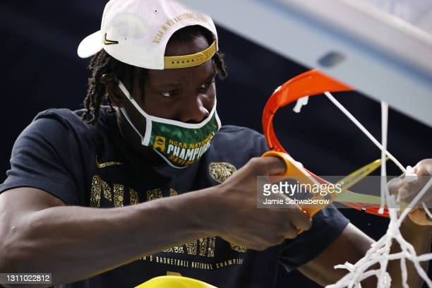 Jonathan Tchamwa Tchatchoua of the Baylor Bears cuts the net after defeating the Gonzaga Bulldogs in the National Championship game of the 2021 NCAA...