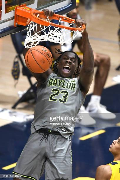 Jonathan Tchamwa Tchatchoua of the Baylor Bears dunks the ball in the first half during a college basketball game against the West Virginia...