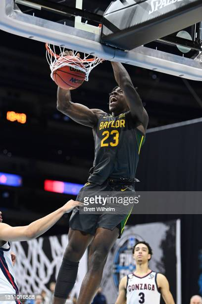 Jonathan Tchamwa Tchatchoua of the Baylor Bears dunks the ball against the Baylor Bears during the second half of the National Championship game of...