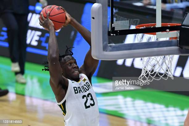 Jonathan Tchamwa Tchatchoua of the Baylor Bears slams home two points in the first half against the Hartford Hawks in the first round of the 2021...