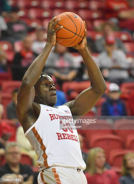 Jonathan Tchamwa Tchatchoua of the UNLV Rebels looks to pass against the Wyoming Cowboys during their game at the Thomas Mack Center on January 05...
