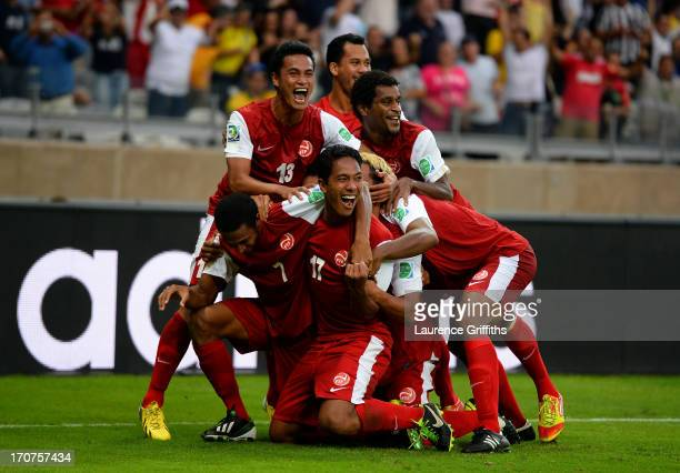 Jonathan Tehau of Tahiti celebrates with his team-mates after scoring his team's first goal during the FIFA Confederations Cup Brazil 2013 Group B...
