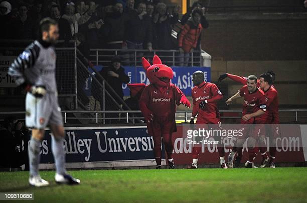 Jonathan Tehoue of Leyton Orient celebrates his goal with team mates during the FA Cup sponsored by EON 5th Round match between Leyton Orient and...