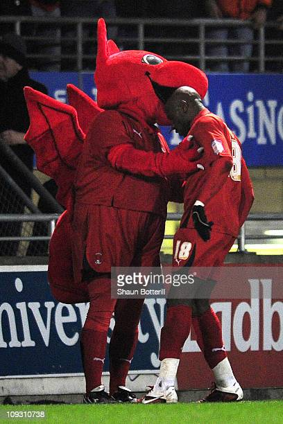 Jonathan Tehoue of Leyton Orient celebrates his goal with the club mascot during the FA Cup sponsored by EON 5th Round match between Leyton Orient...