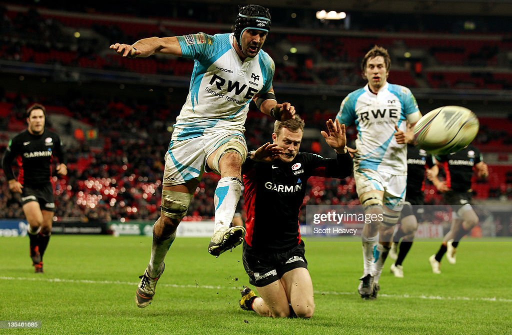 Jonathan Thomas of Ospreys clears the ball from James Short of Saracens during the Heineken Cup Match between Saracens and Ospreys at Wembley Stadium on December 10, 2011 in London, England.