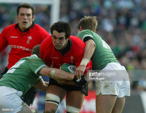 Jonathan Thomas of Wales is wrapped up by the Irish defence during the RBS 2004 Six Nations match between Ireland and Wales at Lansdowne Road on...