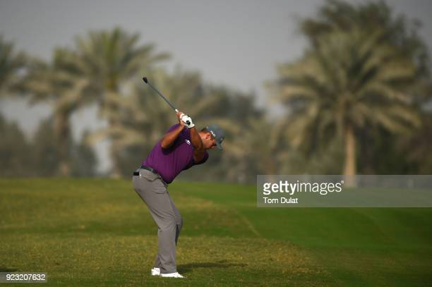 Jonathan Thomson of England hits an approach shot on the 5th hole during the second round of the Commercial Bank Qatar Masters at Doha Golf Club on...