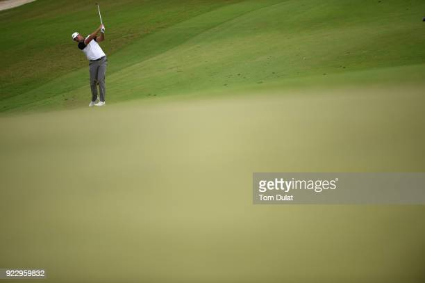 Jonathan Thomson of England hits an approach shot on the 7th hole during the first round of the Commercial Bank Qatar Masters at Doha Golf Club on...