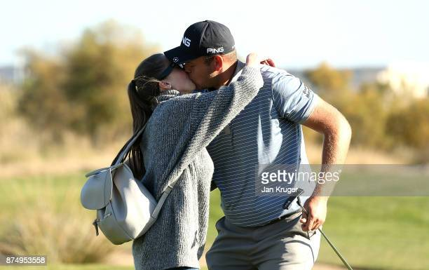 Jonathan Thomson of England is congratulated by his girlfriend after earning his card during the final round of the European Tour Qualifying School...