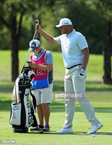 Jonathan Thomson of England prepares to play his second shot into the sixth green during the second round of the Tshwane Open at Pretoria Country...