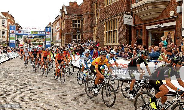 Jonathan Tiernan-Locke of Great Britain passes through Guildford High Street during the 1st passage of the final stage of the Tour of Britain on...