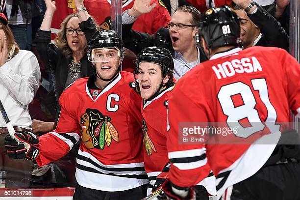 Jonathan Toews and Andrew Shaw of the Chicago Blackhawks celebrate after Toews scored against the Winnipeg Jets in the first period of the NHL game...