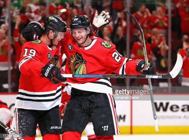 Jonathan Toews and Brandon Saad of the Chicago Blackhawks celebrate Saads' shorthanded goal in the third period against the New Jersey Devils at the...
