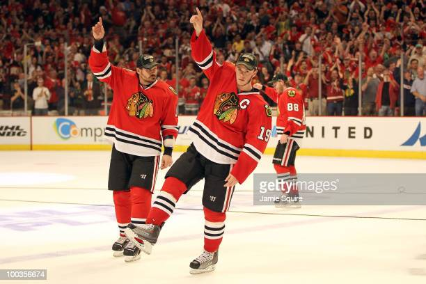 Jonathan Toews and Brent Sopel of the Chicago Blackhawks celebrate as the Blackhawks defeat the San Jose Sharks 42 to advance to the Stanley Cup...