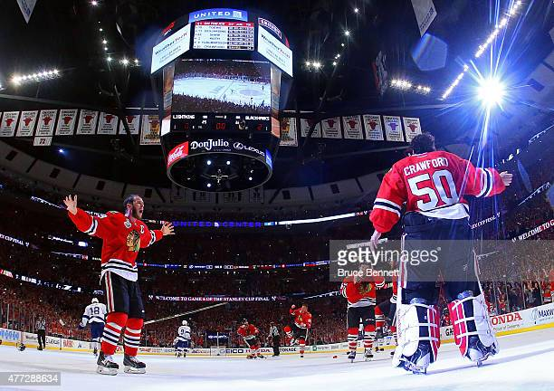 Jonathan Toews and Corey Crawford of the Chicago Blackhawks celebrate after defeating the Tampa Bay Lightning by a score of 2-0 in Game Six to win...