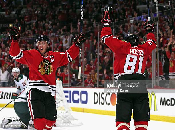 Jonathan Toews and Marian Hossa of the Chicago Blackhawks celebrate Toews' second period goal against the Minnesota Wild in Game Two of the Western...