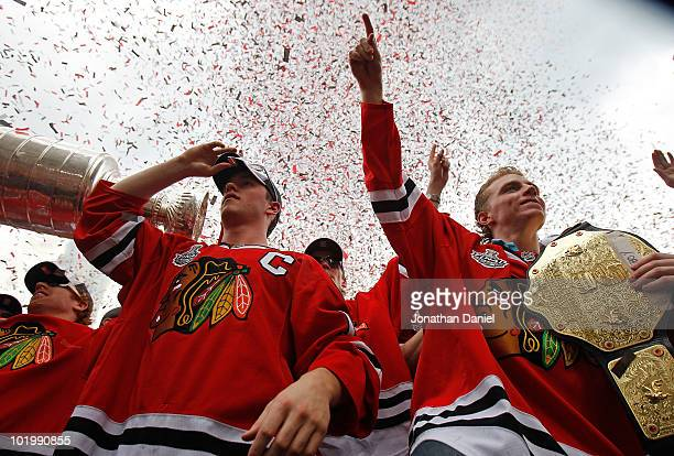 Jonathan Toews and Patrick Kane celebrate with the crowd during the Chicago Blackhawks Stanley Cup victory parade and rally on June 11 2010 in...
