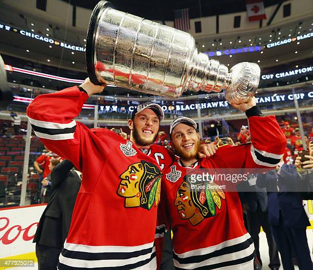 Jonathan Toews and Patrick Kane of the Chicago Blackhawks celebrate by hoisting the Stanley Cup after defeating the Tampa Bay Lightning by a score of...