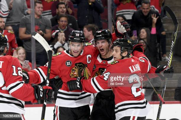 Jonathan Toews Brandon Saad and Dominik Kahun of the Chicago Blackhawks celebrate after Saad scored in the first period against the Anaheim Ducks at...