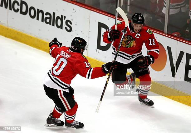 Jonathan Toews celebrates his second period goal with Patrick Sharp of the Chicago Blackhawks against the Tampa Bay Lightning during Game Four of the...