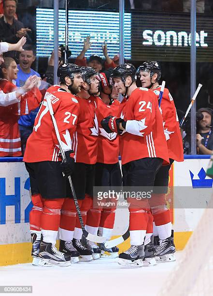 Jonathan Toews celebrates with Alex Pietrangelo Corey Perry and Jay Bouwmeester of Team Canada after scoring a second period goal on Team Europe...