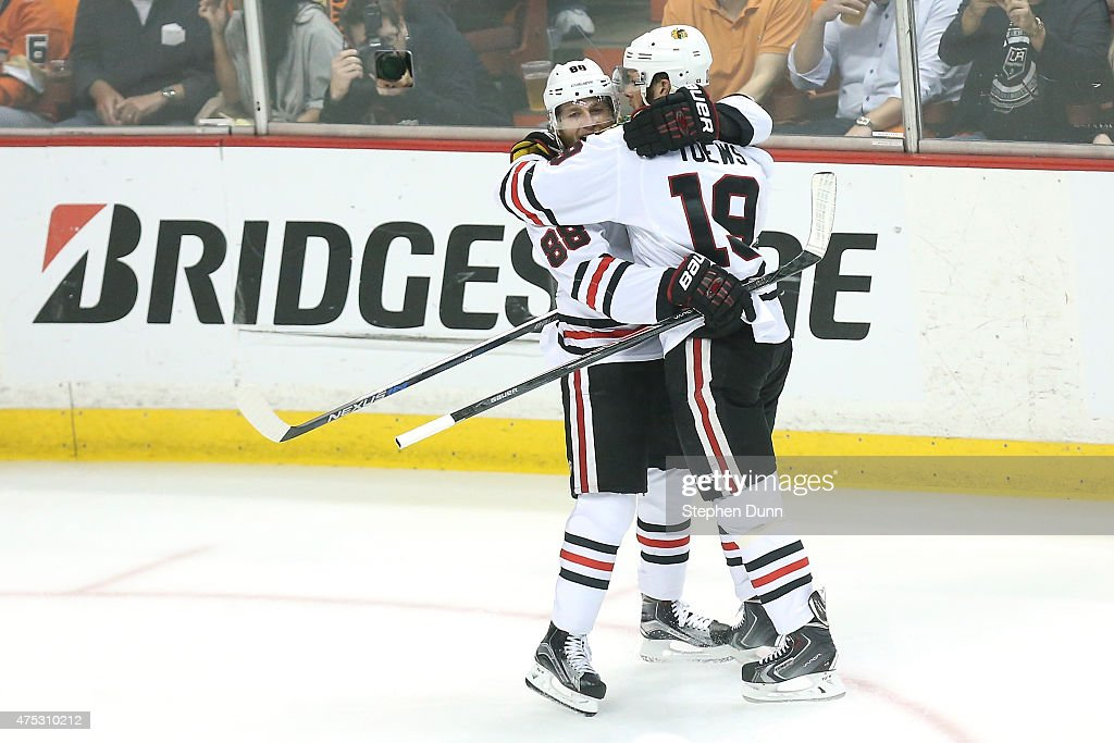 Jonathan Toews #19 celebrates with Patrick Kane #88 after Toews scores in the first period against the Anaheim Ducks in Game Seven of the Western Conference Finals during the 2015 NHL Stanley Cup Playoffs at the Honda Center on May 30, 2015 in Anaheim, California.