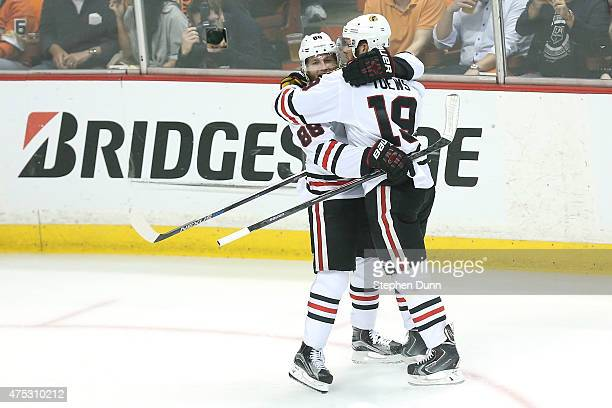 Jonathan Toews celebrates with Patrick Kane after Toews scores in the first period against the Anaheim Ducks in Game Seven of the Western Conference...