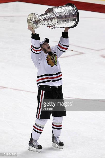 Jonathan Toews hoists the Stanley Cup after teammate Patrick Kane scored the gamewinning goal in overtime to defeat the Philadelphia Flyers 43 and...