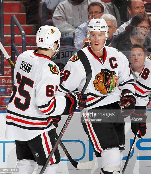 Jonathan Toews is congratulated by Andrew Shaw of the Chicago Blackhawks after scoring a second period goal against the Florida Panthers at the BBT...