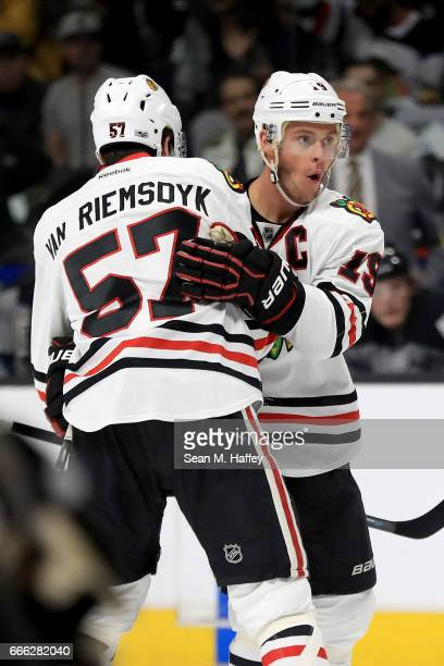 Jonathan Toews is congratulated by Trevor van Riemsdyk of the Chicago Blackhawks after scoring a goal during the first period of a game against the...
