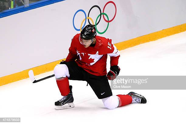 Jonathan Toews of Canada celebrates after scoring the opening goal against Henrik Lundqvist of Sweden in the first period during the Men's Ice Hockey...