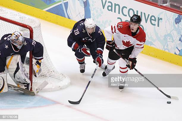 Jonathan Toews of Canada is challenged by Brian Rafalski of the United States during the ice hockey men's gold medal game between USA and Canada on...