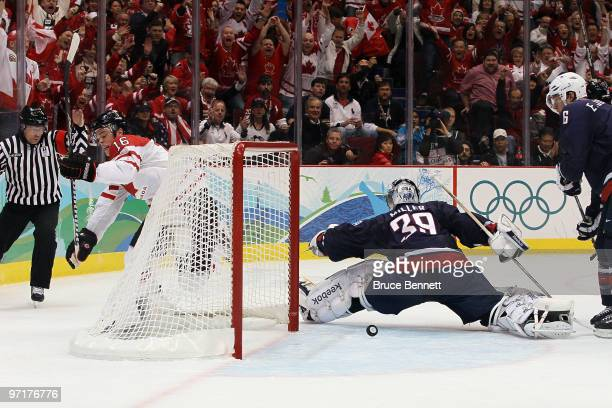 Jonathan Toews of Canada scores a goal past Ryan Miller of the United States during the ice hockey men's gold medal game between USA and Canada on...