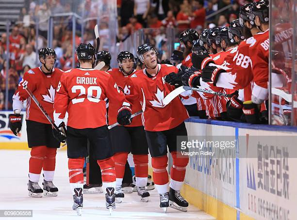 Jonathan Toews of Team Canada high fives the bench after scoring a first period goal on Team Europe during the World Cup of Hockey 2016 at Air Canada...