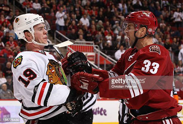 Jonathan Toews of the Chicago Blackhawks and Adrian Aucoin of the Phoenix Coyotes come together in a scrum during the NHL game at Jobing.com Arena on...