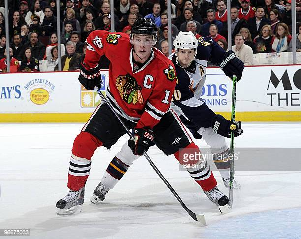 Jonathan Toews of the Chicago Blackhawks and Colby Armstrong of the Atlanta Thrashers wait in position for the puck on February 13 2010 at the United...