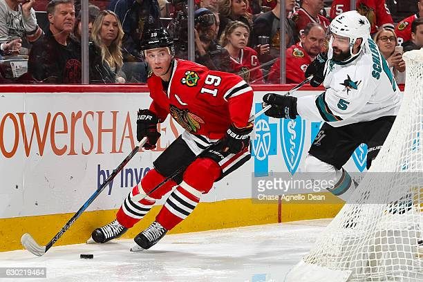 Jonathan Toews of the Chicago Blackhawks and David Schlemko of the San Jose Sharks chase the puck in the second period at the United Center on...