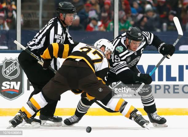 Jonathan Toews of the Chicago Blackhawks and Patrice Bergeron of the Boston  Bruins face off during. 2019 Bridgestone NHL Winter ... 2637827f1