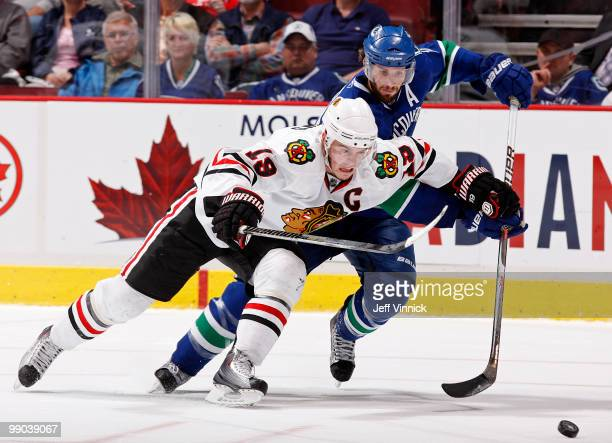 Jonathan Toews of the Chicago Blackhawks and Ryan Kesler of the Vancouver Canucks race towards the puck in Game 6 of the Western Conference...