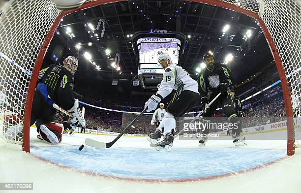 Jonathan Toews of the Chicago Blackhawks and Team Toews can't control the puck for the shot on goal as goaltender Carey Price of the Montreal...