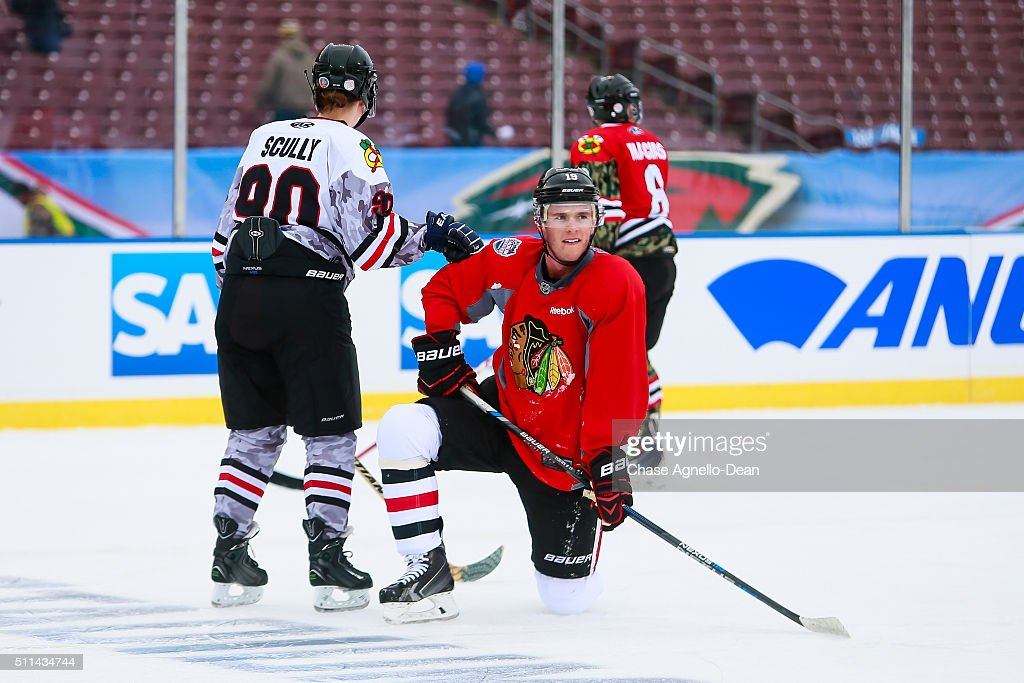Jonathan Toews #19 of the Chicago Blackhawks and the Wounded Warriors hockey team skate during practice day for the 2016 Coors Light Stadium Series game against the Minnesota Wild at TCF Bank Stadium on February 20, 2016 in Minneapolis, Minnesota.