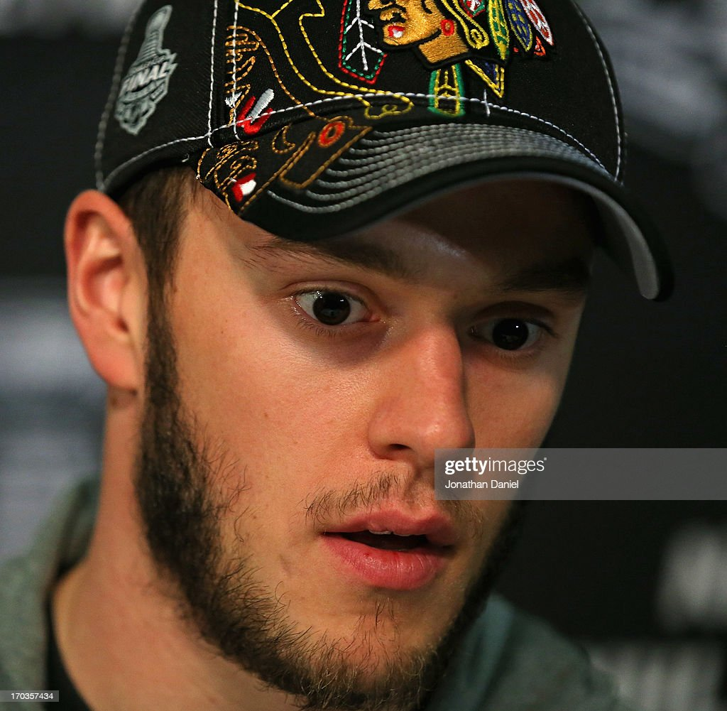 Jonathan Toews #19 of the Chicago Blackhawks answers questions during the 2013 NHL Stanley Cup media day at the United Center on June 11, 2013 in Chicago, Illinois.