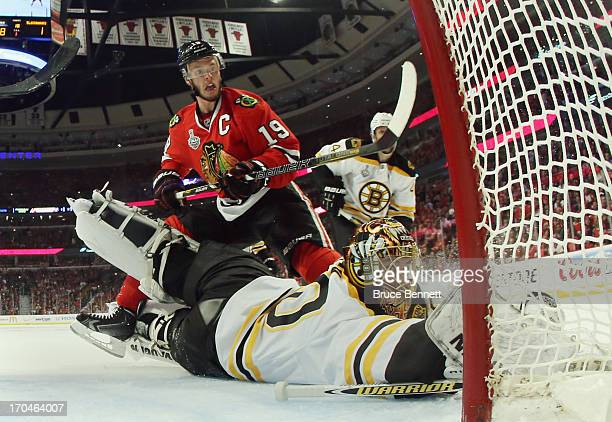 Jonathan Toews of the Chicago Blackhawks attacks the net against Tuukka Rask of the Boston Bruins at the United Center during Game One of the NHL...