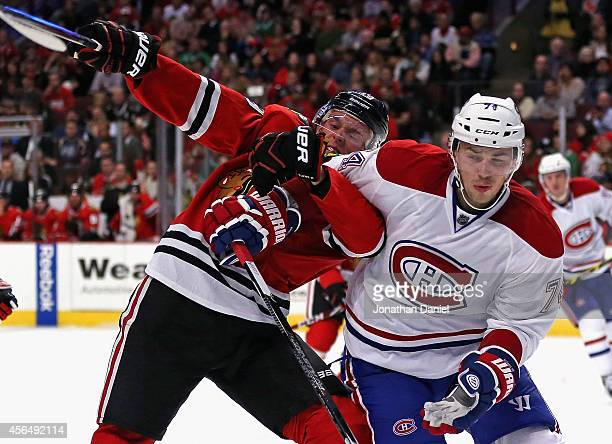 Jonathan Toews of the Chicago Blackhawks battles for position with Alexei Emelin of the Montreal Canadiens during a preason game at the United Center...
