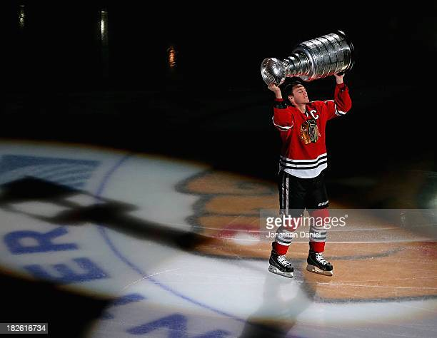Jonathan Toews of the Chicago Blackhawks carries the Stanley Cup one last time during a ceremony before taking on the Washington Capitals at the...